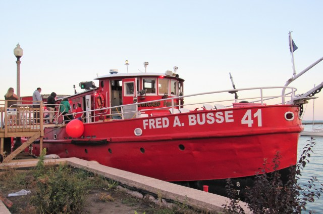 Side view of a squatty, one-level red fireboat