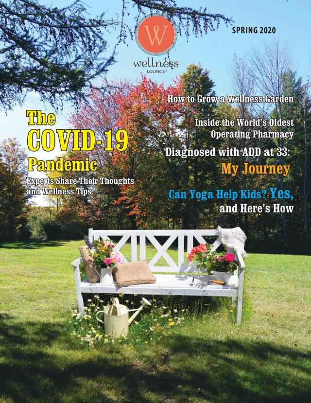 A magazine cover with photo of white bench in a grassy park
