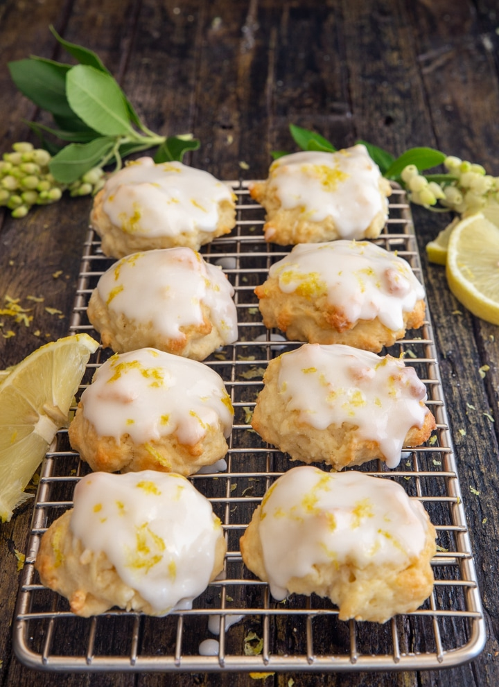 ricotta cookies on a wire rack with slices of lemon