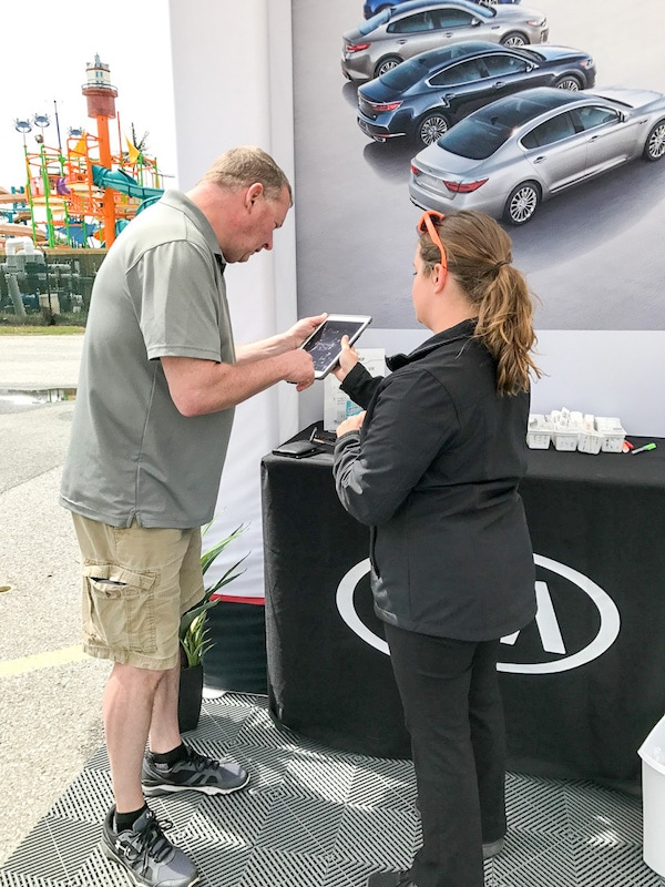Sean signing up for the Kia Ride and Drive