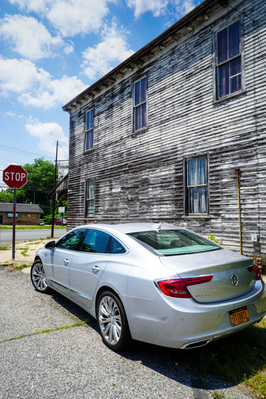 Buick LaCrosse by old store