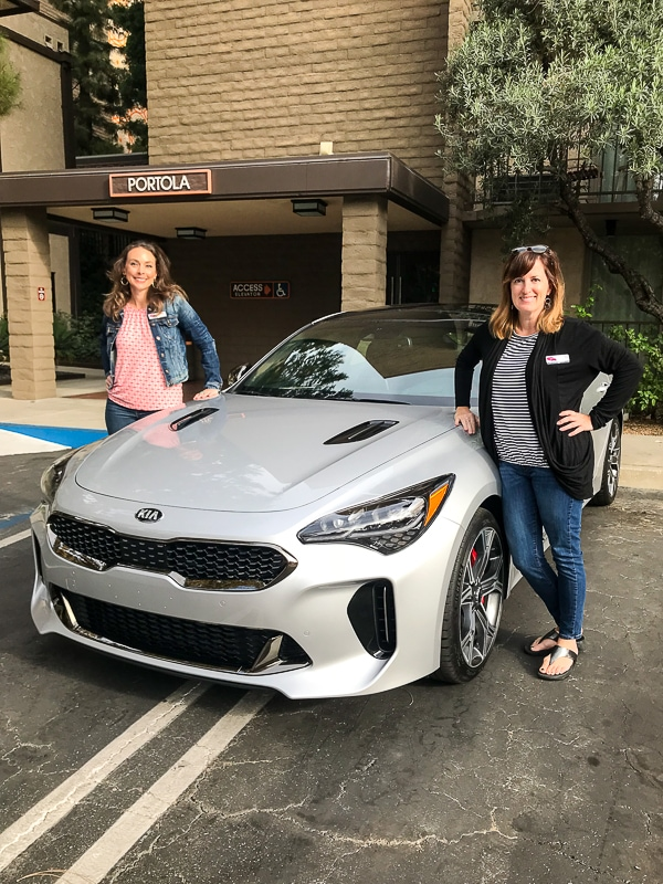 Fadra and Meagan in the Kia Stinger