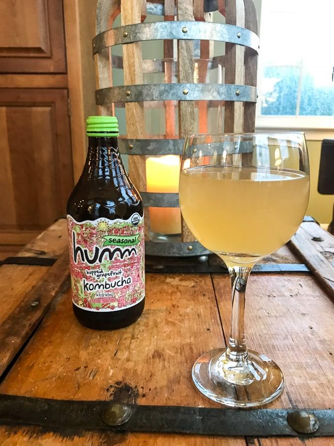 humm kombucha in a wine glass