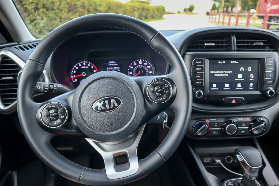 Leather wrapped steering wheel and shifter