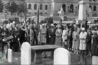 Members of the Bergen County Historical Society laying a wreath on General Poor's grave in the early twentieth century. (Photo from the collections of the Bergen County Historical Society)