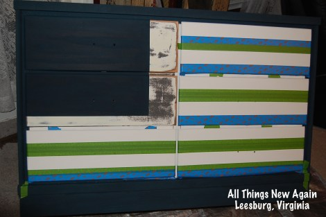 Use painter's tape for crisp stripes on your Patriotic American Flag Dresser. See full tutorial at: www.AllThingsNewAgain.net