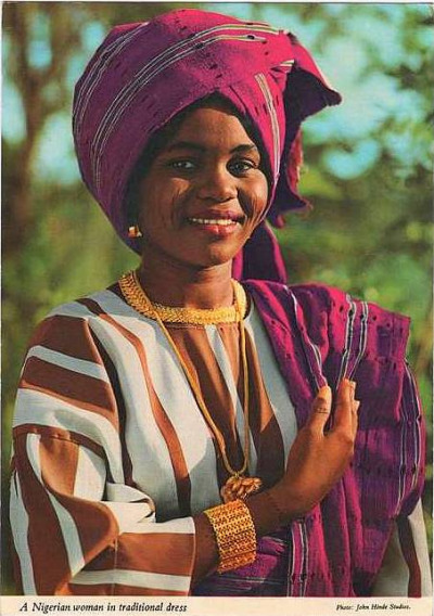 A young lady wearing a complete Aso oke in vibrant colour in the 1980s. Photo-by-John-Hinde