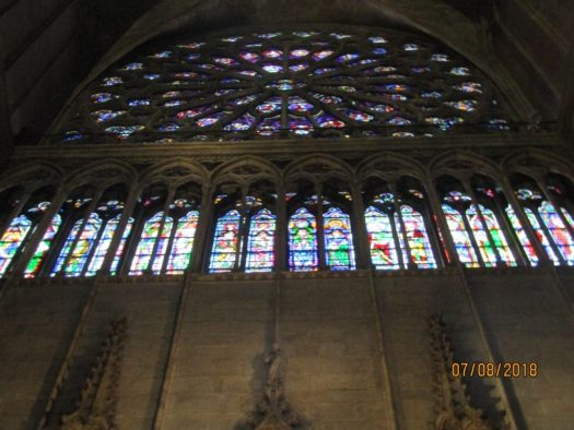 Looking up towards a beautiful S rose window of Notre Dame Cathedral-photo by Lysandra Furstenberg