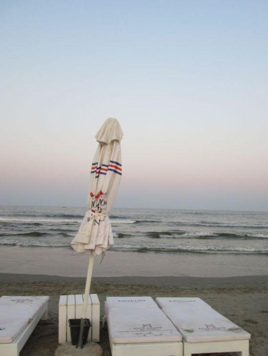 striped beach umbrella by the sea @PatFurstenberg