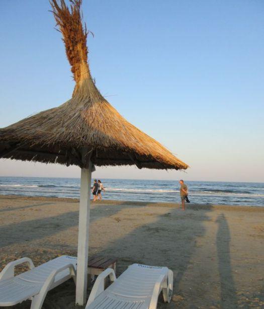 straw beach umbrella by the sea @PatFurstenberg