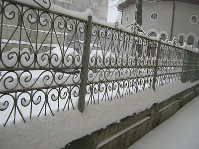 snow on a fence in winter