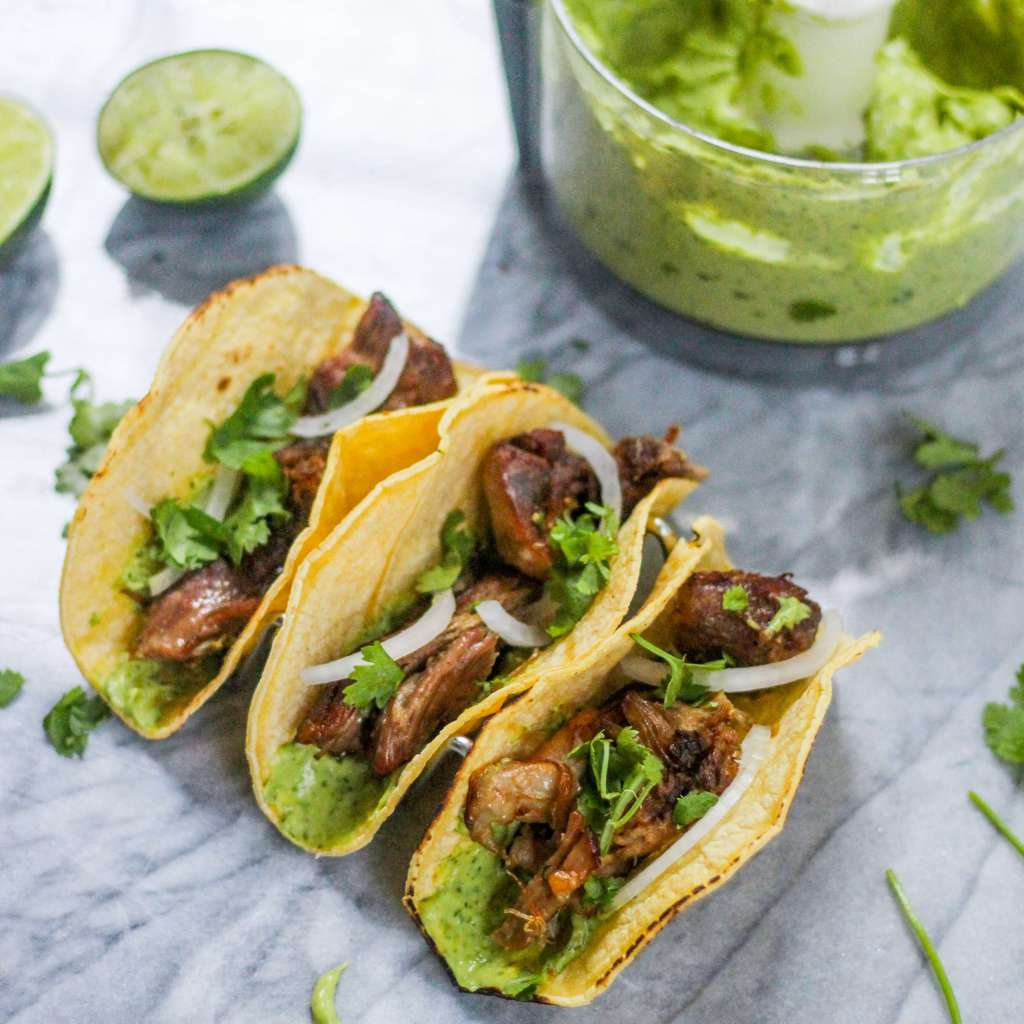 Crispy Crockpot Carnitas with Spicy Avocado Crema