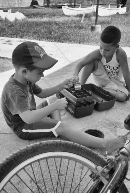 Boys playing with tackle box