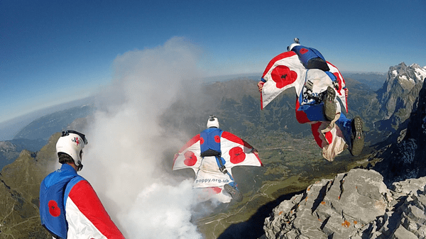 Alastair Macartney and the Jump4Heroes exit the north face of the Eiger for a wingsuit formation flight.  Photo by Chris Douggs McDougall.