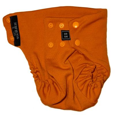 Orange tygblöja sett framifrån halvt öppnad