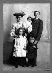 Elmer L. McIntosh, holding baby Carl, and Flora and their children Ione and Elmer Daniel 2nd