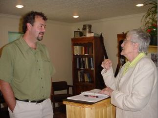 #1b Brad Hager, AHS bd of directors, talks with AHS office volunteer Lillian Hanks