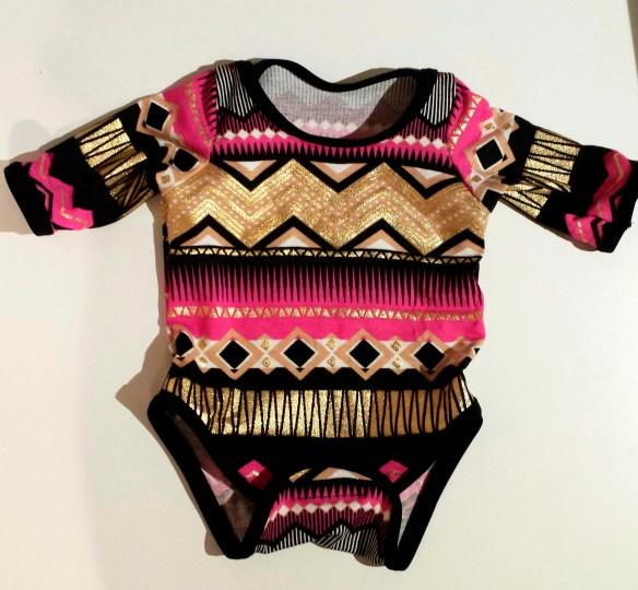 almond rock dylan onesie babygrow spit up and stilettos metallic gold hot pink jersey