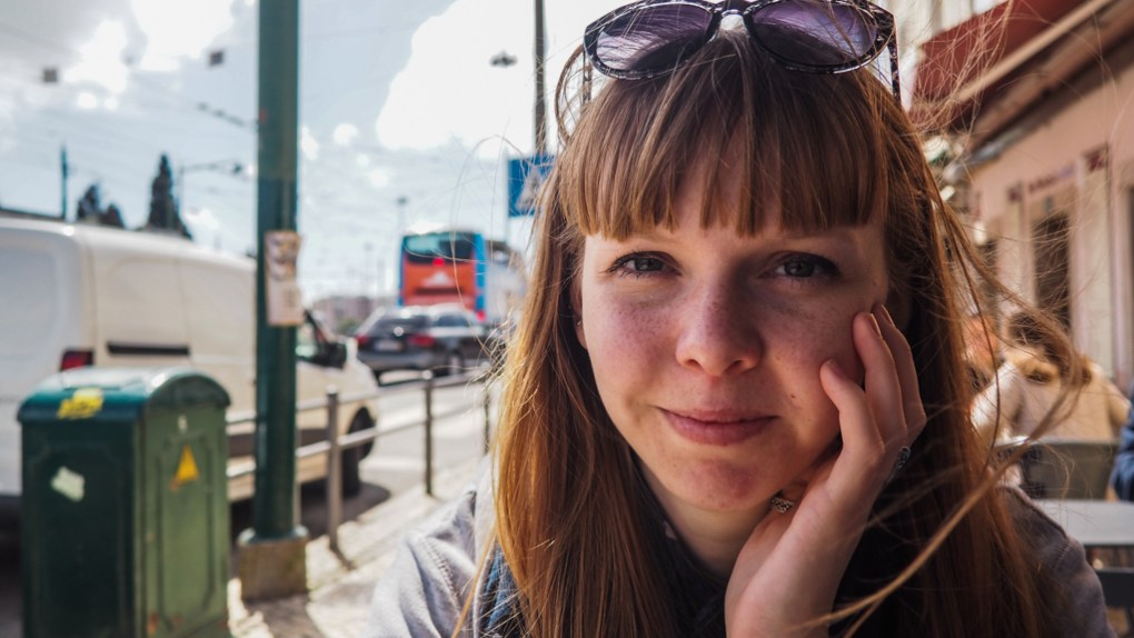 Almost Ginger blog owner sitting at an outside table at a restaurant in Belém, Lisbon in Portugal | 3 Days in Lisbon Itinerary