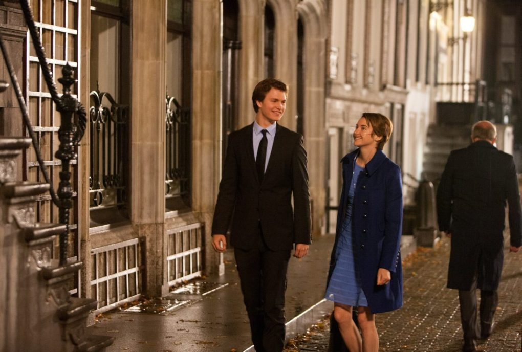 The Fault in Our Stars (2014) film still of Gus and Hazel walking towards their restaurant in Amsterdam