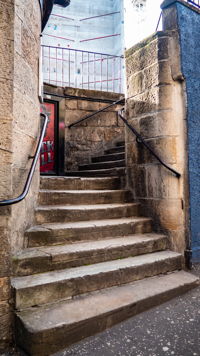 Steps onto Calton Road in Edinburgh which is a Trainspotting film location