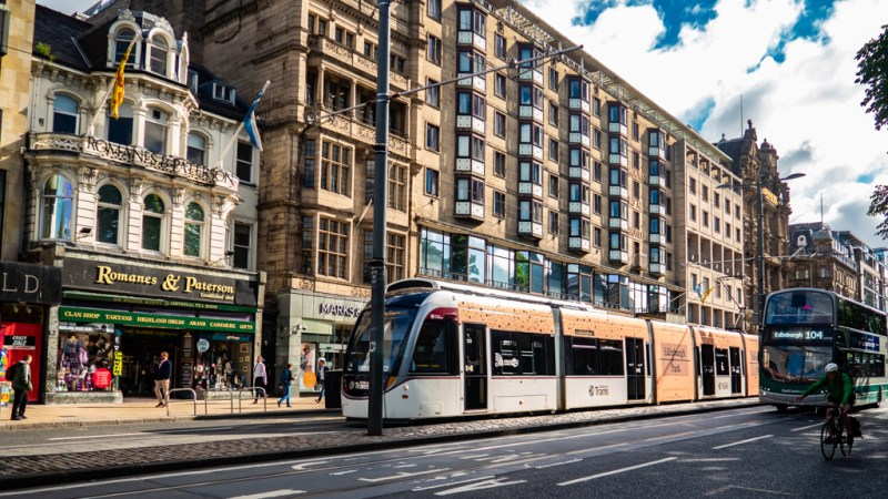 Buses and Trams on Princes Street which is a Trainspotting film location