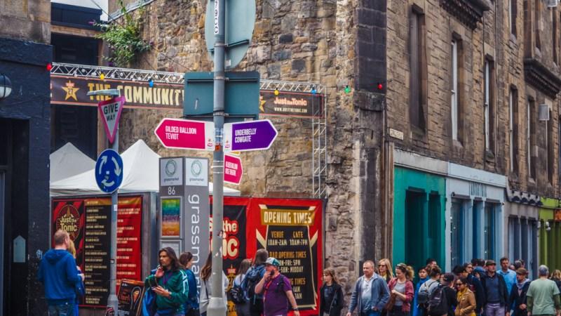 Street, venue and signpost at the Edinburgh Fringe Festival in Scotland, UK