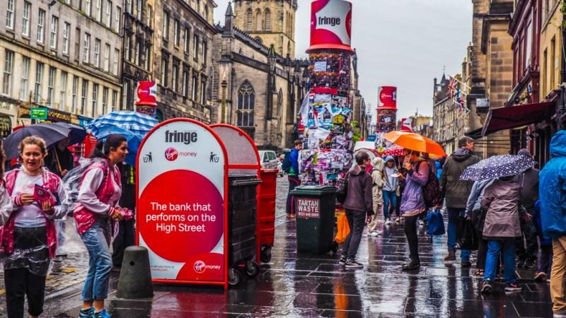 The Royal Mile in the rain at the Edinburgh Fringe Festival in Scotland, UK