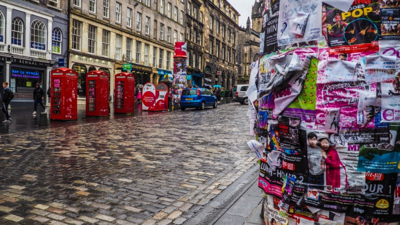 Posters on an empty Royal Mile during the Edinburgh Fringe Festival in Scotland, UK