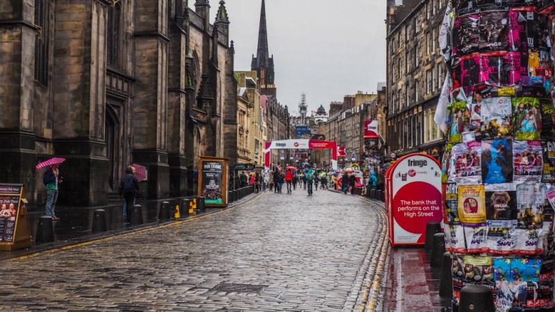 Empty, rainy Royal Mile during the Edinburgh Fringe Festival in Scotland, UK