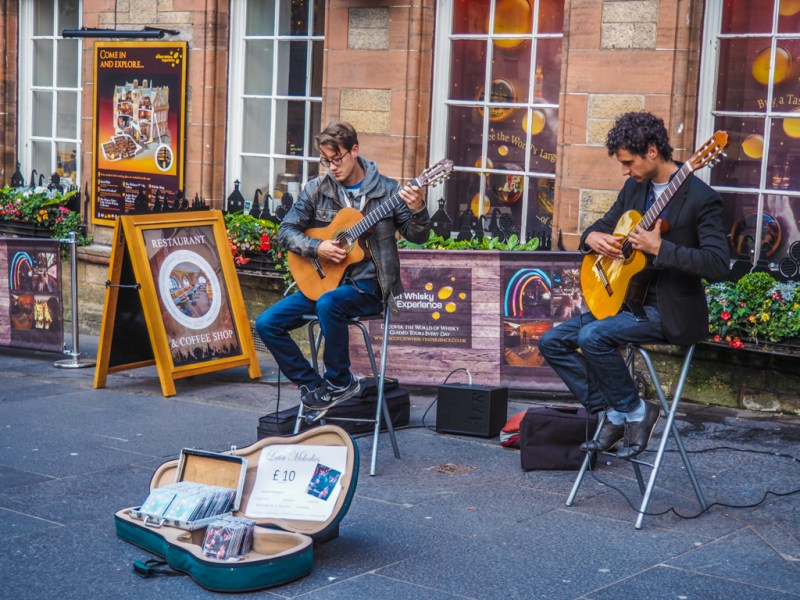 Musicians performing on the Royal Mile during the Edinburgh Fringe Festival in Scotland, UK