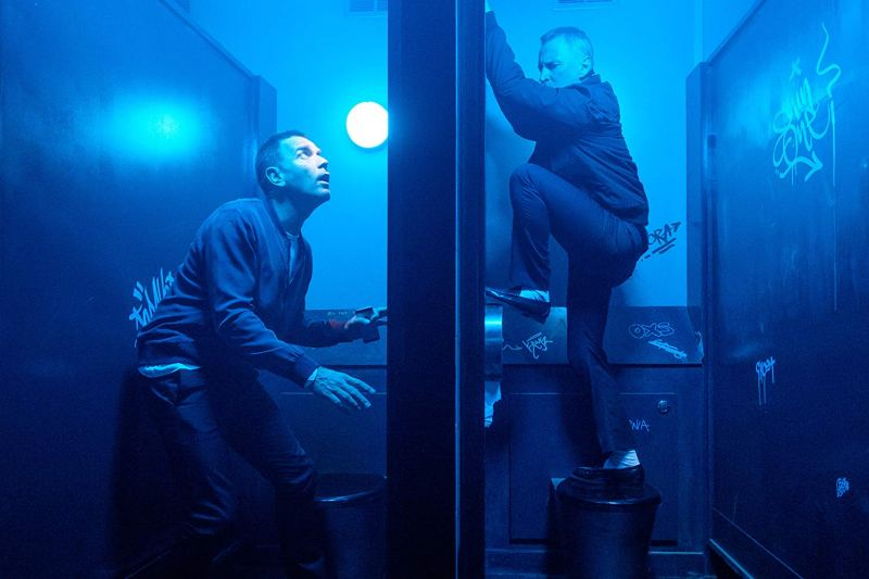 Ewan McGregor hiding from Robert Carlyle in The Cav toilets in the film T2 Trainspotting (2017)