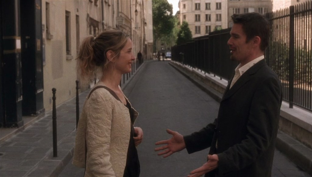 Before Sunset (2004) film still of Celine and Jesse facing each other on a Paris street