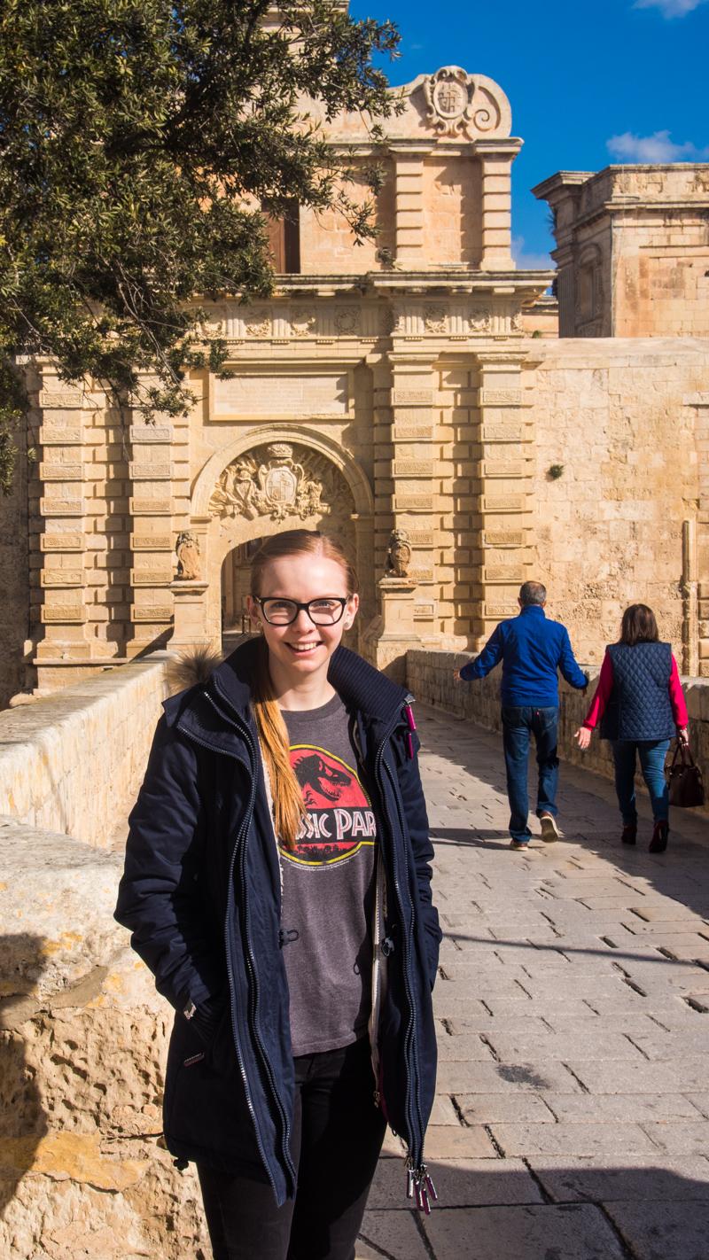 Almost Ginger blog owner outside Mdina City Gate in Malta