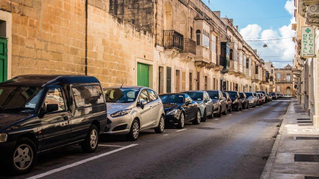 Street lined with cars in Rabat, Malta