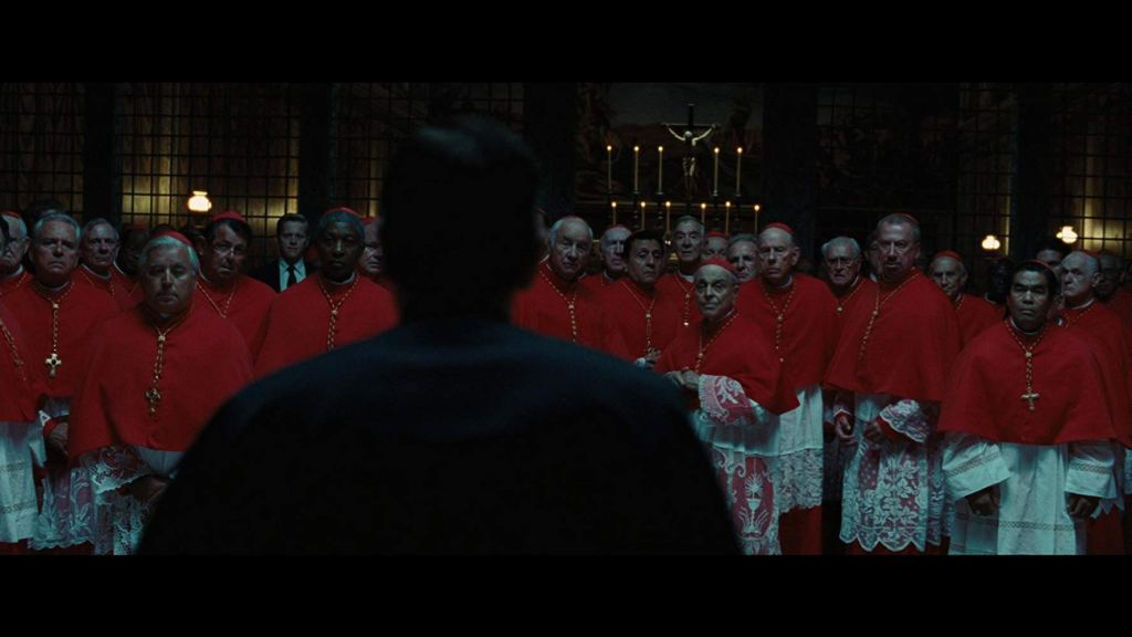 Cardinals and Father Patrick McKenna in the Sistine Chapel during conclave as seen in Angels and Demons (2009)