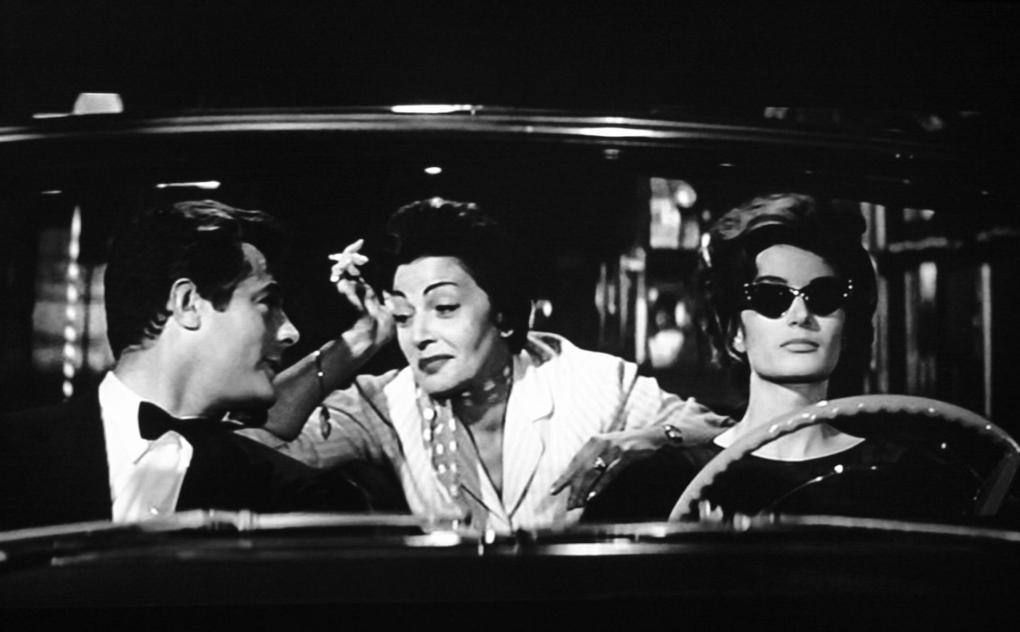 Marcello and Maddelena in her cadillac in Rome, Italy, one of the La Dolce Vita filming locations