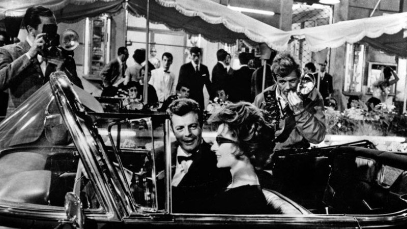 Marcello and Maddelena in her cadillac on the Via Veneto in Rome, Italy, one of the La Dolce Vita filming locations