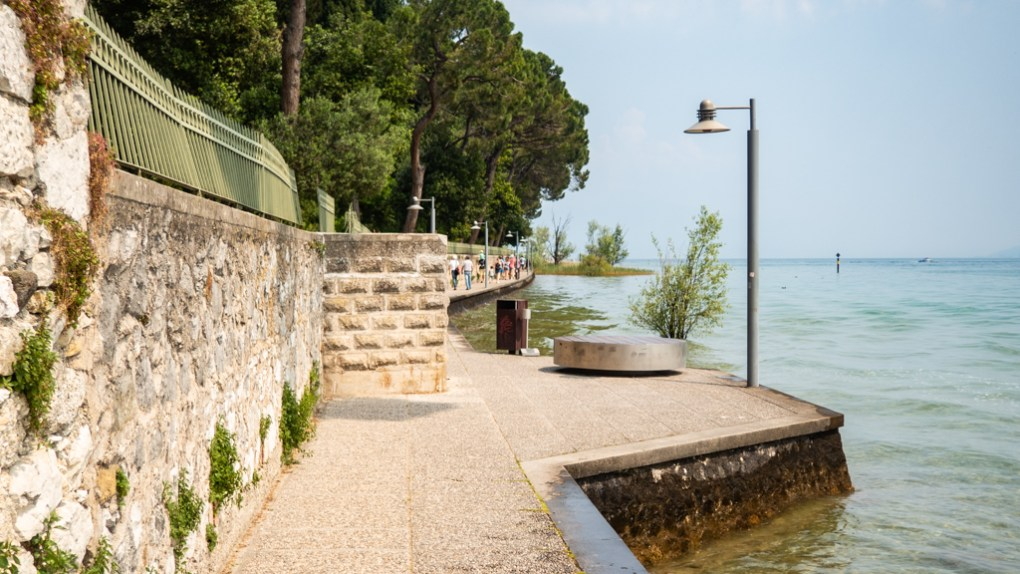 Path around Sirmione public beach on Lake Garda, Italy