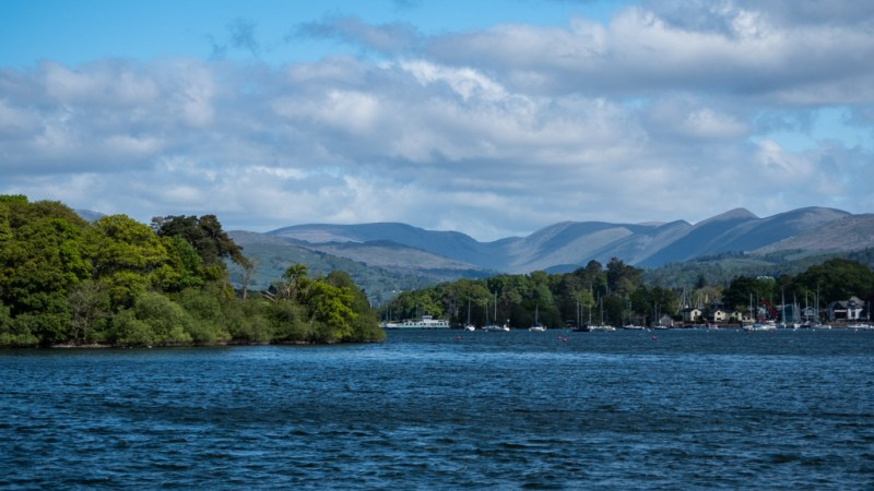 Hills in the distance of Lake Windermere in Bowness-On-Windermere in the Lake District, UK