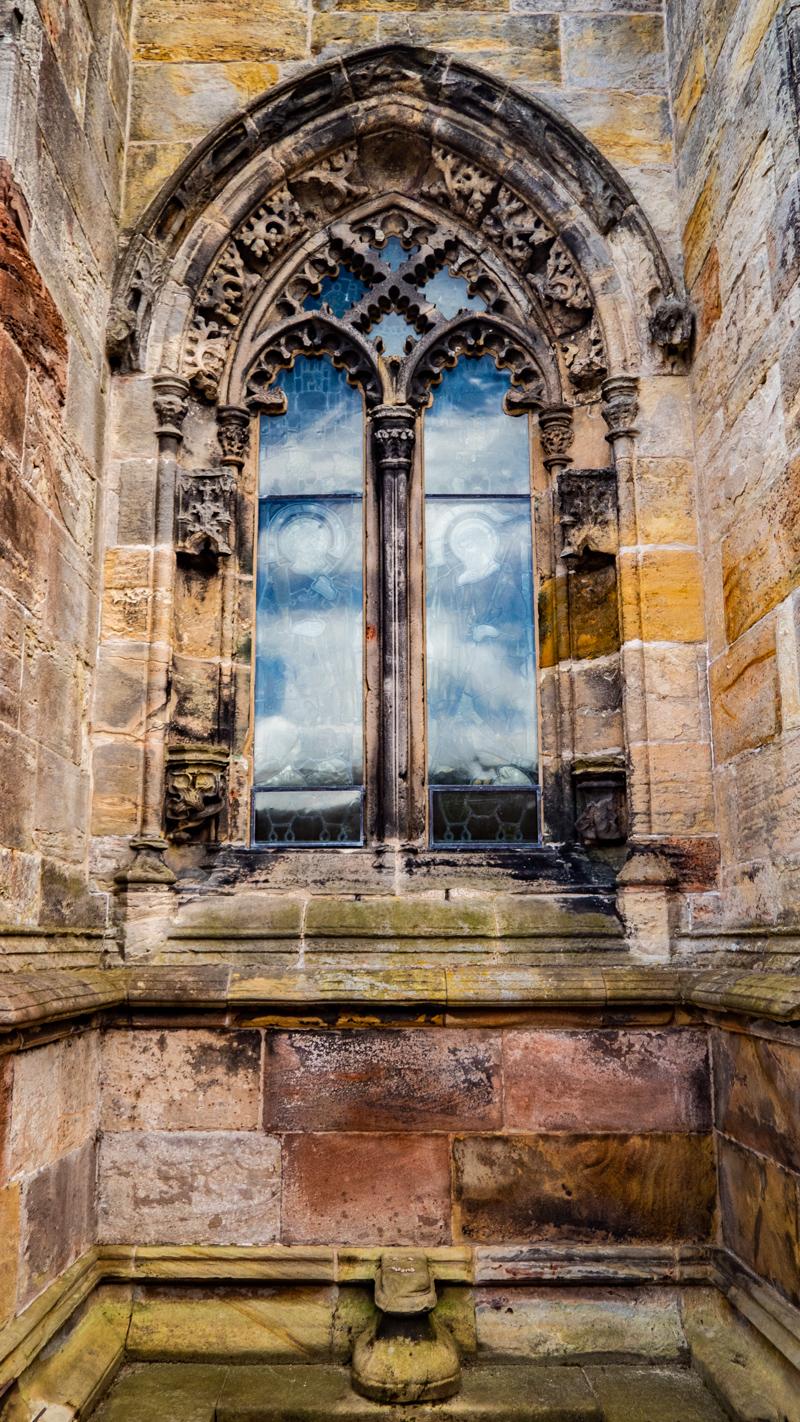A stain glass window at Rosslyn Chapel in Edinburgh, UK