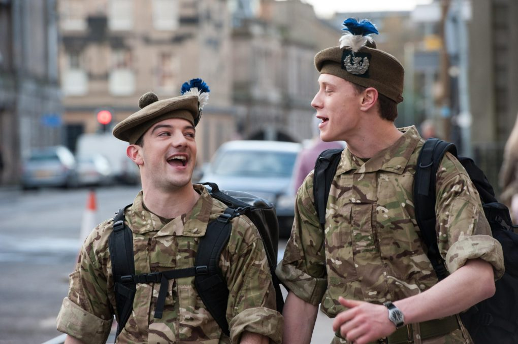 Davy and Ally walking down a road in Leith from the film Sunshine on Leith (2013)