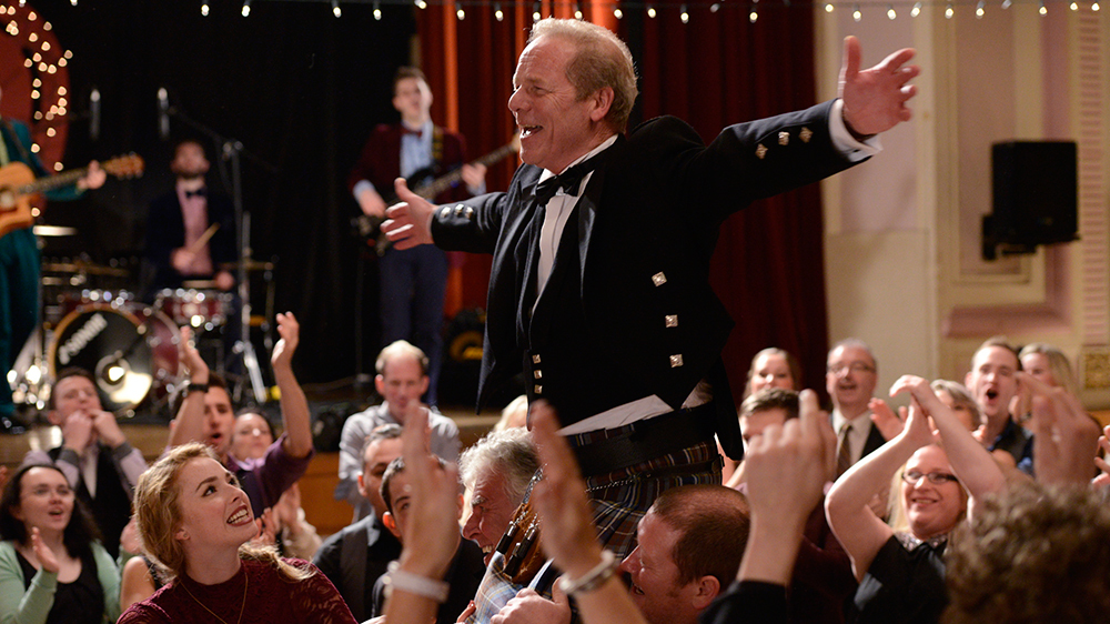 Rab at his anniversary party in Sunshine on Leith (2013)