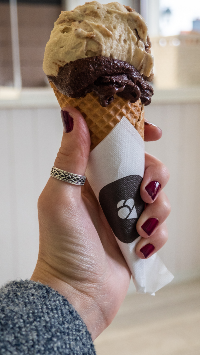 Almost Ginger blog owner holding a gelato from Lody Naturalne in Wrocław, Poland