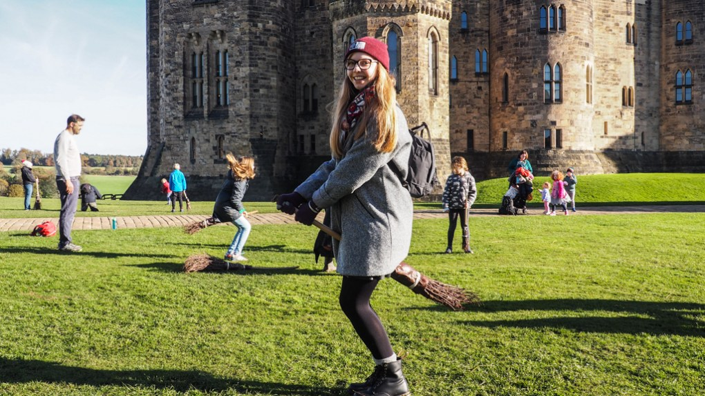 Almost Ginger blog owner taking broomstick lessons at Alnwick Castle, a Harry Potter Filming Location in North East England