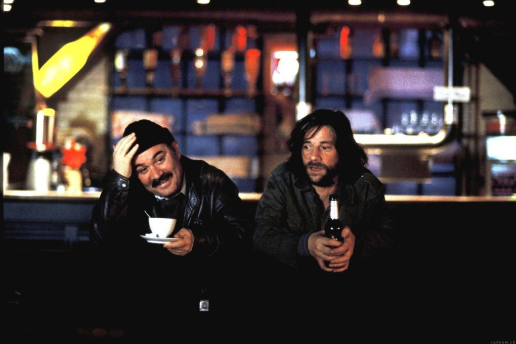 Film still from Head-On (2004) of two men drinking in a bar