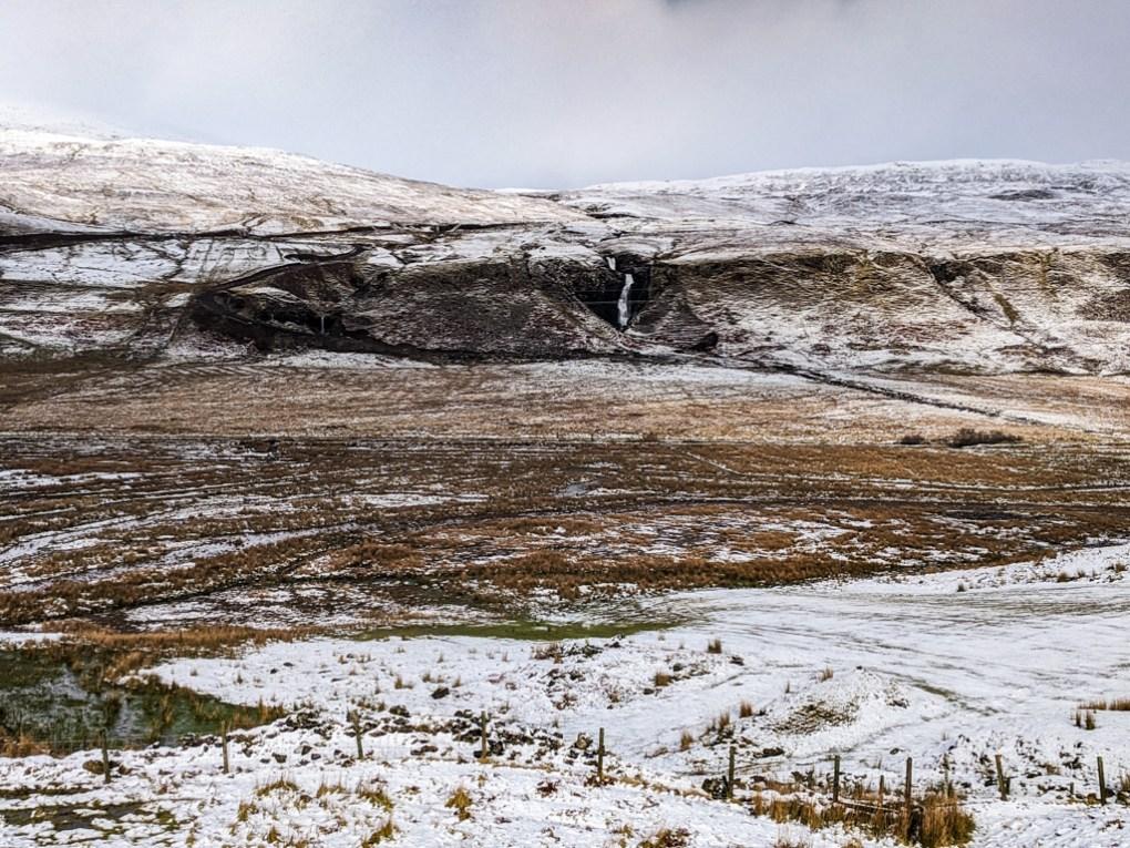 Snowy waterfall near The Fairy Glen in Uig on the Isle of Skye, Scotland