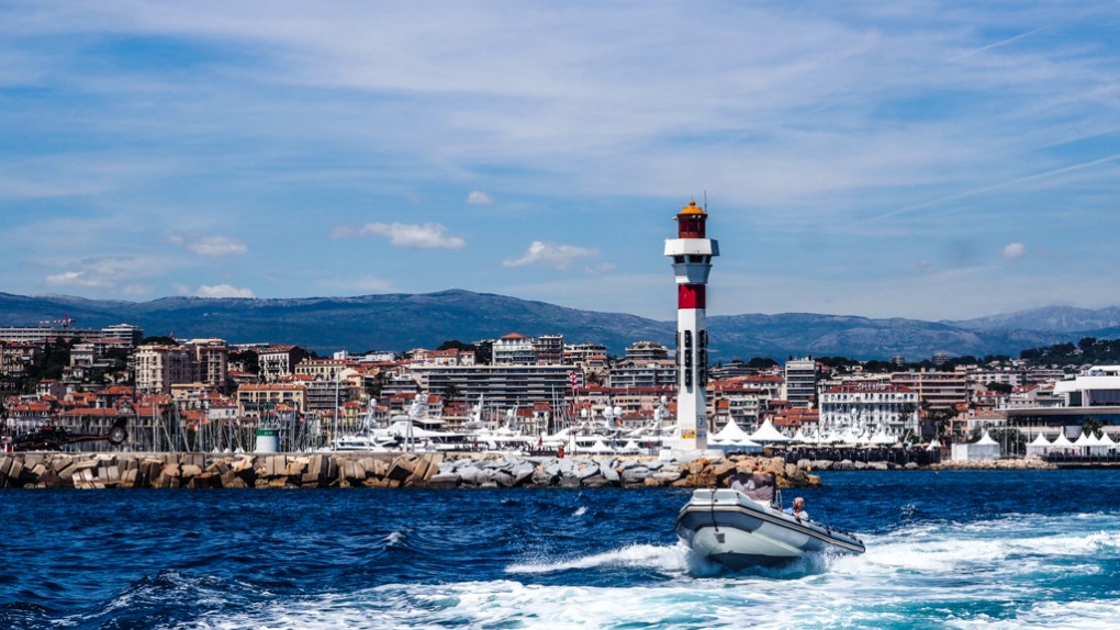 Red and white lighthouse in Cannes Harbour in the South of France