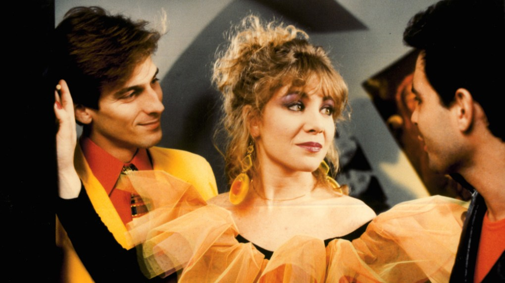 Labyrinth of Passion (1982) film still of two men and a woman in 1980s clothes