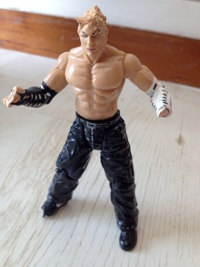 Scalped, handless wrestler